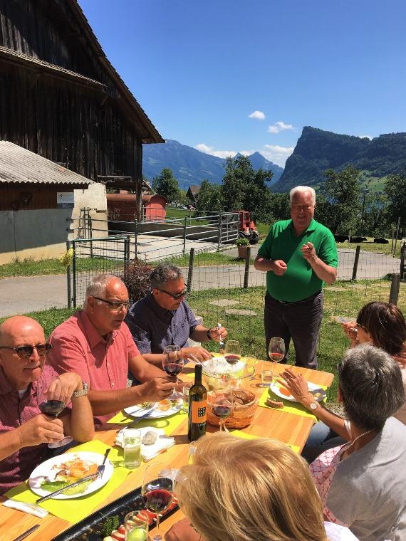 people at a table tasting local food on a tour